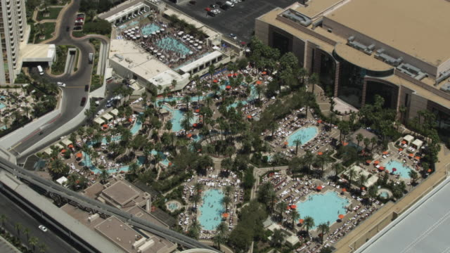orbital shot of mgm grand pool complex in las vegas - mgm grand las vegas stock videos & royalty-free footage