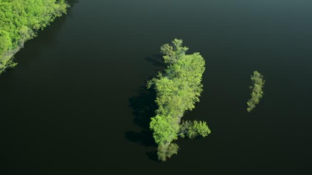 orbital shot of small island near reads landing - minnesota stock videos & royalty-free footage
