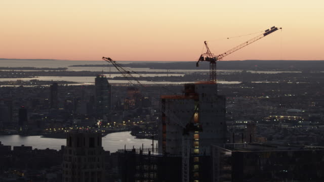 Orbital shot of the 3 World Trade Center under construction during sunrise