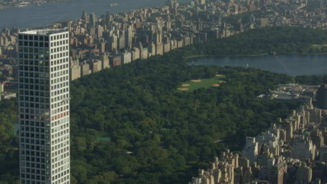 Orbital shot of the 432 Park Avenue with the Central Park in the background