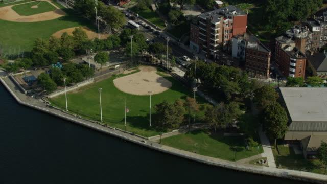 orbital shot of the baseball field in langone park the former site of the molasses tank - チャールズ川点の映像素材/bロール