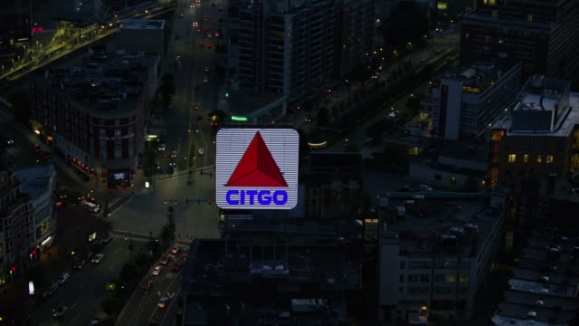 orbital shot of the citgo sign in downtown boston at night - back bay boston stock videos & royalty-free footage