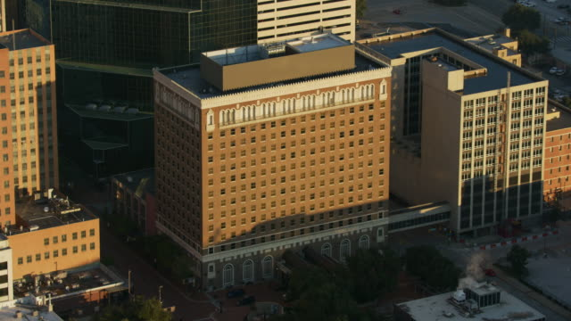 orbital shot of the hilton fort worth at sunrise - street name sign stock videos & royalty-free footage