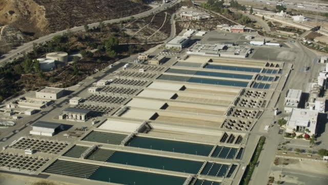 orbital shot of the metropolitan water district pools - irrigation equipment stock videos & royalty-free footage