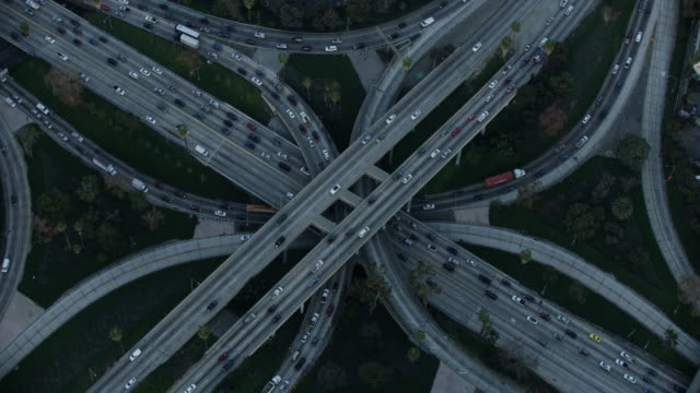 Orbital shot of the morning traffic on a freeway interchange in Los Angeles