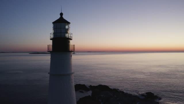 orbital shot of the portland head light at sunset - north atlantic ocean stock videos & royalty-free footage