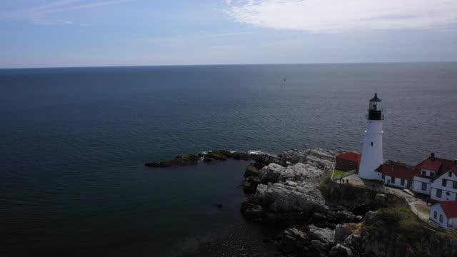 orbital shot of the portland head light in casco bay - north atlantic ocean stock videos & royalty-free footage