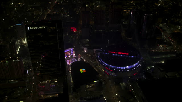 orbital shot of the staples center in downtown los angeles - microsoft theater los angeles stock videos & royalty-free footage
