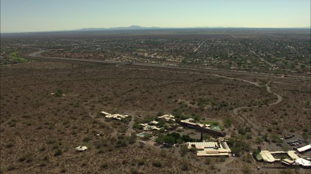 orbital shot of the taliesin west by frank lloyd wright in arizona - shrubland stock videos & royalty-free footage