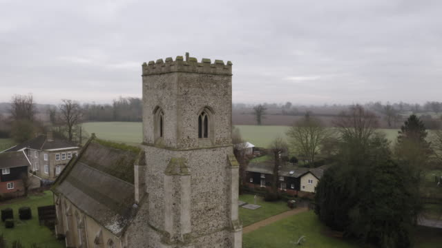 orbital shot of the tower of the church of st mary in troston - veranda stock videos & royalty-free footage
