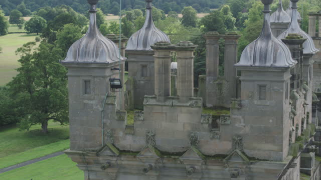 orbital shot of the turret of floors castle - stone object stock videos & royalty-free footage