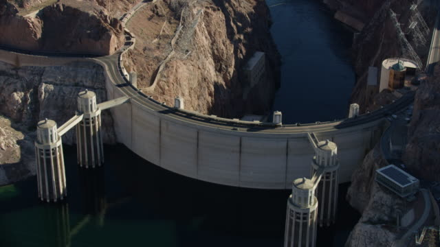 orbital shot of the upstream face of the hoover dam - hoover dam stock videos and b-roll footage