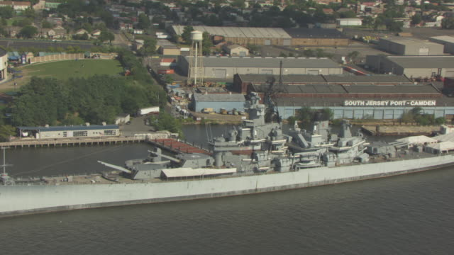 orbital shot of the uss new jersey battleship - デラウェア川点の映像素材/bロール