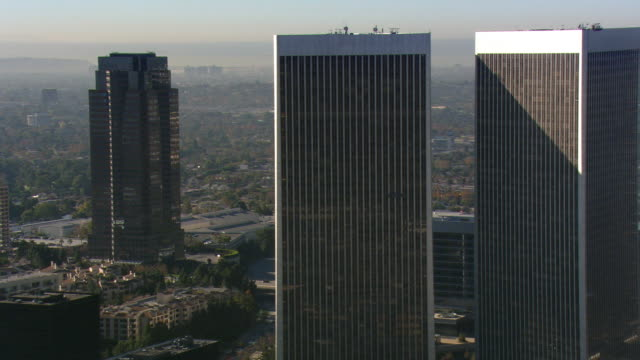 orbiting century city skyscrapers in los angeles area. shot in 2008. - century city stock videos & royalty-free footage
