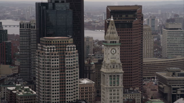 orbiting downtown boston high-rises; custom house tower in foreground. shot in november 2011. - custom house tower stock videos & royalty-free footage