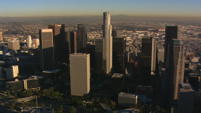 orbiting downtown los angeles with wide view of valley. shot in 2008. - artbeats stock videos & royalty-free footage