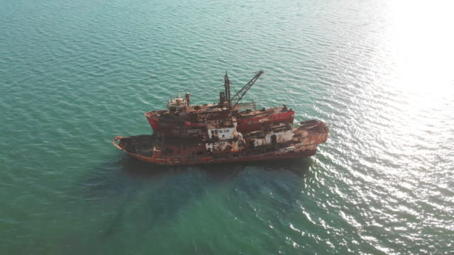 Orbiting drone shot of shipwreck in Port Moresby