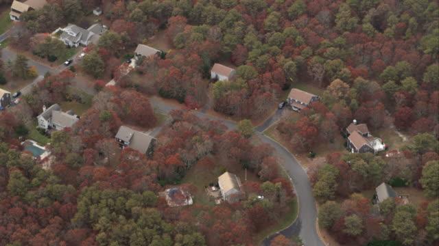 Orbiting homes in wooded neighborhood near Hampton Bays, New York. Shot in November 2011.
