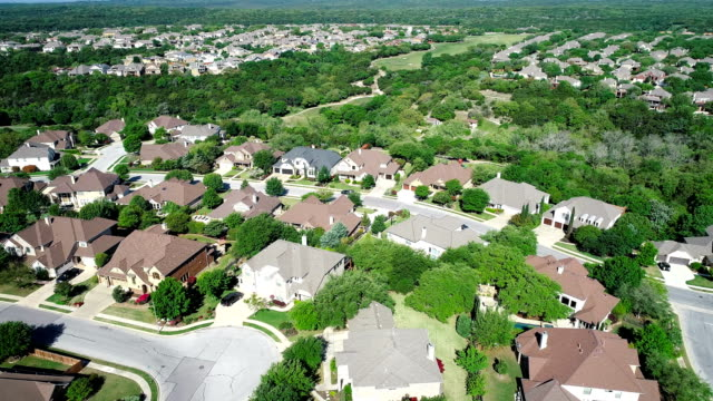 orbiting over cedar park , texas , texas hill country houses and homes suburb development - cedar park texas stock videos & royalty-free footage