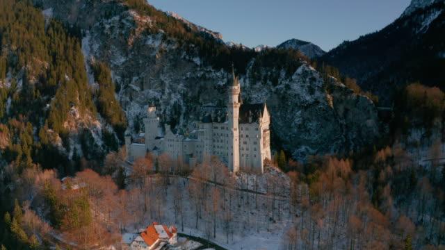 as orbiting the neuschwanstein castle in schongau, germany - wop productions stock-videos und b-roll-filmmaterial