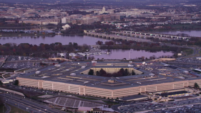 orbiting the pentagon with potomac river and washington dc cityscape in background. shot in 2011. - the pentagon stock videos and b-roll footage