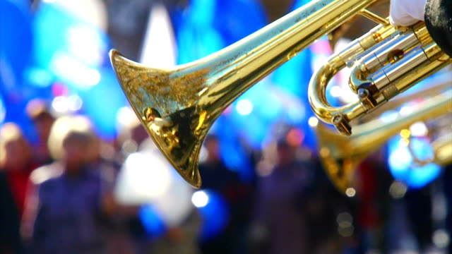 orchestra trumpet on the background of the demonstration - brass band stock videos & royalty-free footage