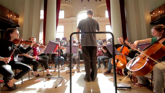 orchestra with conductor wide angle - orchestra stock videos & royalty-free footage