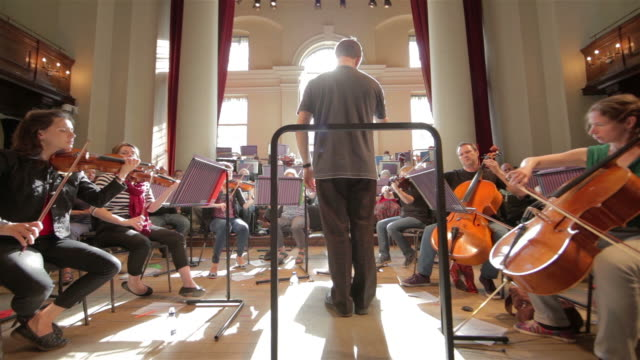 Orchestra with conductor wide angle