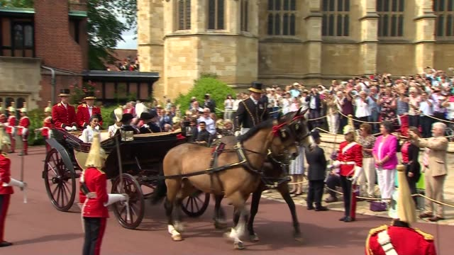 arrivals and departures england berkshire windsor windsor castle carriage along carrying prince william duke of cambridge catherine duchess of... - berkshire england stock videos and b-roll footage