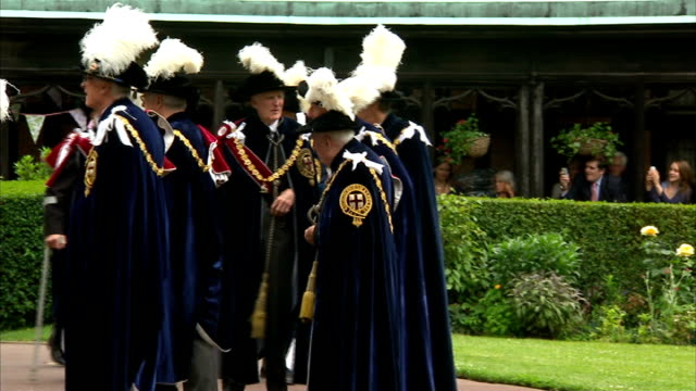 Arrivals and departures ENGLAND Berkshire Windsor Castle St George's Chapel EXT Royal Guards standing on steps as bells tolling SOT / Knights of the...