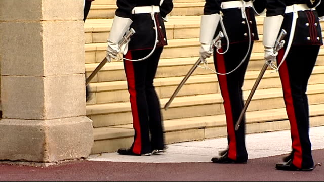 order of the garter ceremony at windsor castle; england: berkshire: windsor castle: st george's chapel: ext procession of household cavalry guards... - military uniform stock videos & royalty-free footage
