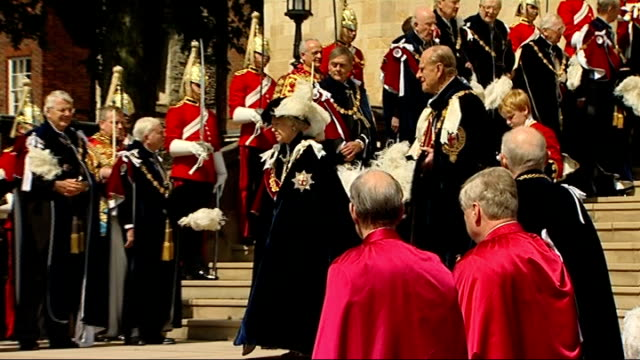 cutaways john major standing with other knights of garter outside chapel/ queen elizabeth and prince philip down chapel steps towards waiting... - john major stock videos & royalty-free footage