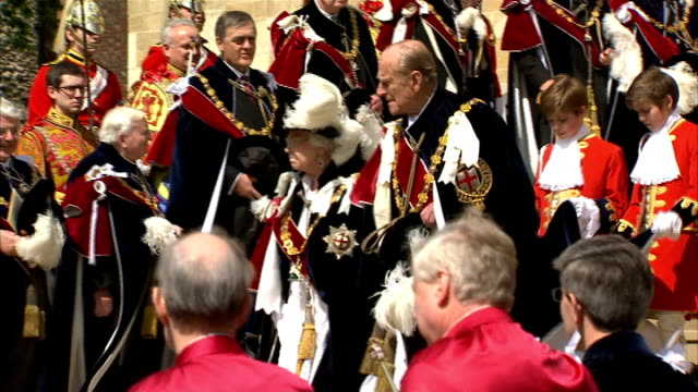 order of the garter ceremony princess anne prince andrew down steps followed by prince charles prince william and prince edward / queen and prince... - ceremony stock videos and b-roll footage