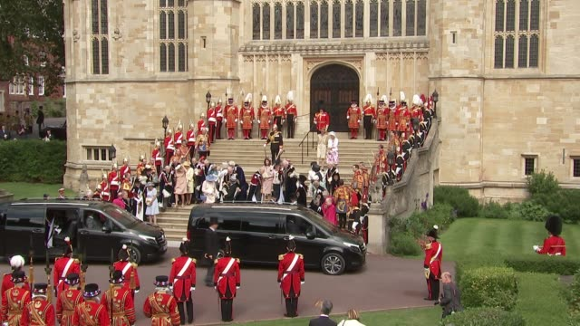 order of the garter ceremony: st george's chapel arrivals and departures; england: berkshire: windsor: windsor castle: gvs dignitaries on steps... - メアリー ピータース点の映像素材/bロール