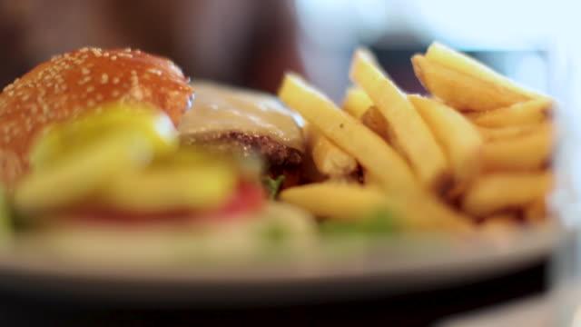 order up -  cheeseburger, garnish and fries - cheeseburger stock videos & royalty-free footage