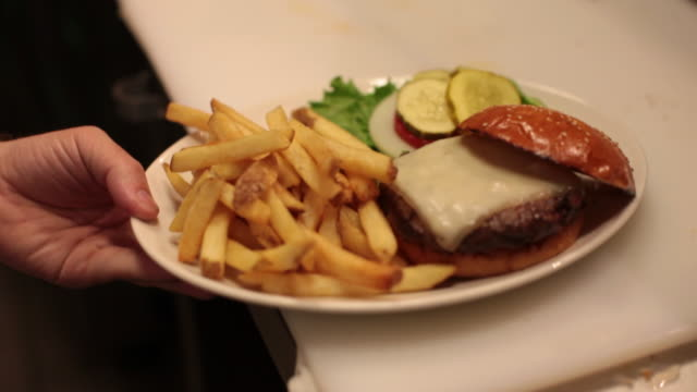 order up -  cheeseburger, garnish and fries - unhealthy eating stock videos & royalty-free footage