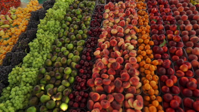 orderly rows of fruits in traditional european market in malta - apple fruit stock videos & royalty-free footage
