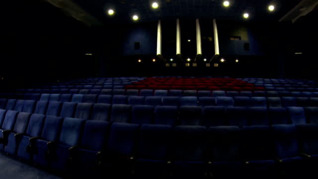 ordinary and vip armchairs in the cinema - auditorium stock videos & royalty-free footage