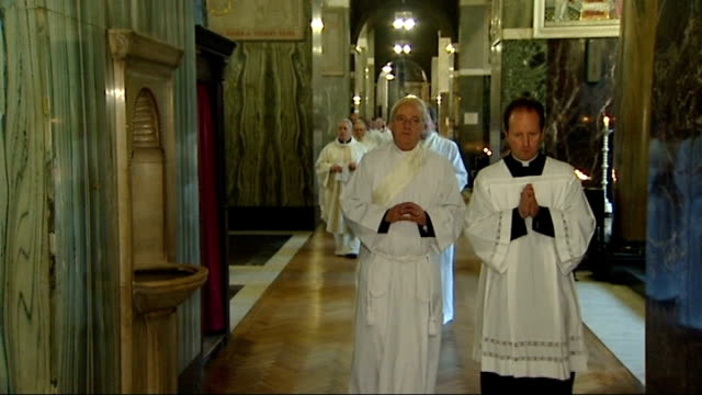 ordination of three ex-anglican bishops into catholic church; england: london: westminster cathedral: int gvs procession of catholic priests in... - westminster cathedral stock videos & royalty-free footage
