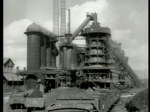 stockvideo's en b-roll-footage met ore train moving up tracks toward hungarian steel mill. train moving under hungarian steel mill exterior funicular railway lifts. wwii - traditionally hungarian