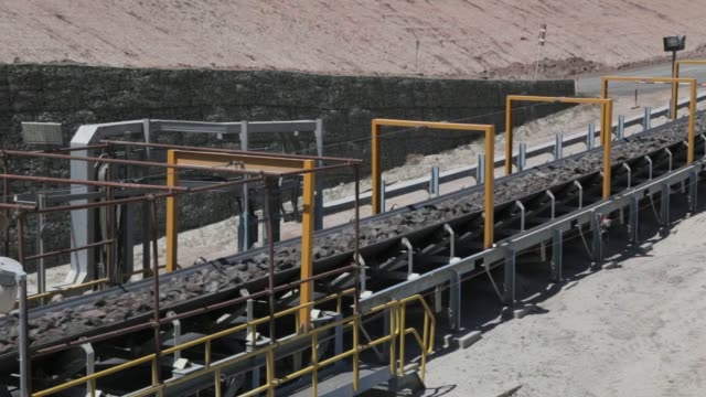 Ore travels along a conveyor to the concentrator at the Oyu Tolgoi copper gold mine jointly owned by Rio Tinto Group's Turquoise Hill Resources Ltd...