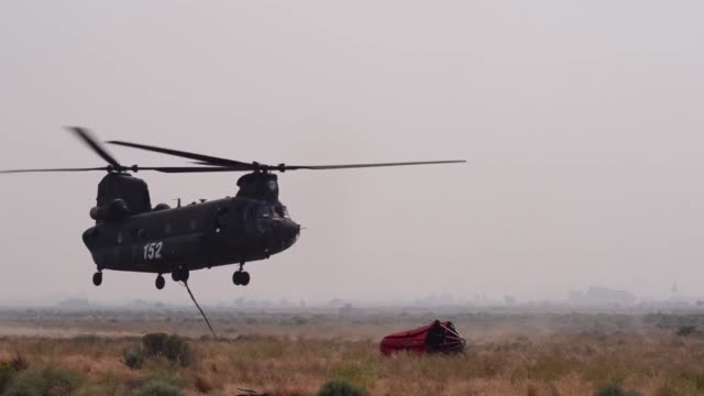 oregon army national guard aviators support local responders in suppressing a wildfire west of madras ore - chennai stock videos & royalty-free footage
