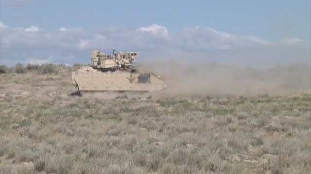 oregon army national guard m2 bradley fighting vehicles from the 3rd battalion 116th heavy brigade combat team square off against m1a2 abrams tanks... - brigade stock videos and b-roll footage