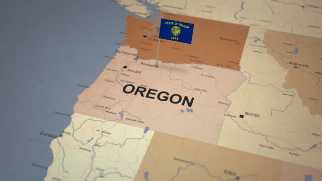 oregon map with state flag - oregon us state stock videos & royalty-free footage