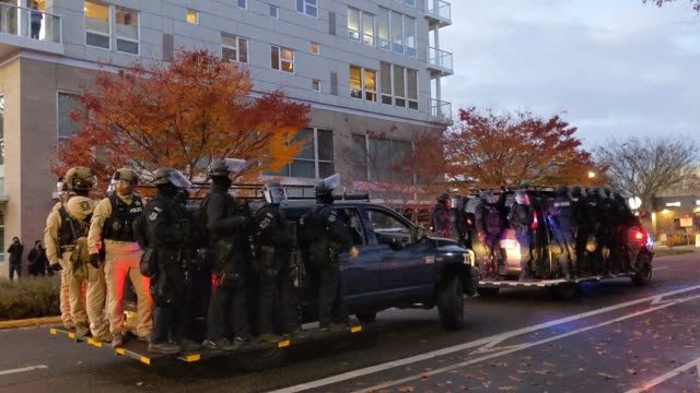 "oregon state police and salem police are yelled at as they ride by on a truck during dueling black lives matter and ""stop the steal"" protests on... - oregon state capitol stock videos & royalty-free footage"