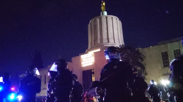 "oregon state police and salem police guard the oregon state capitol building during dueling black lives matter and ""stop the steal"" protests on... - oregon state capitol stock videos & royalty-free footage"