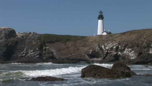 oregonview of oregon coast and yaquina lighthouse in pacific northwest united states - oregon coast stock videos & royalty-free footage