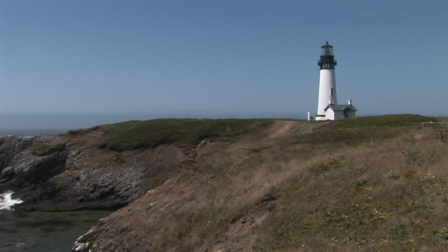 oregonview of yaquina lighthouse in oregon coast pacific northwest united states - oregon coast stock videos & royalty-free footage