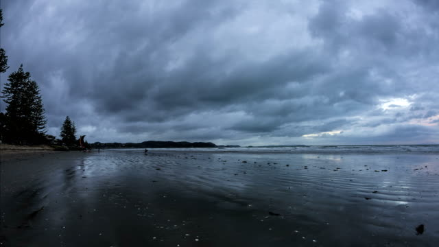 orewa beach timelapse - storm cloud stock videos & royalty-free footage