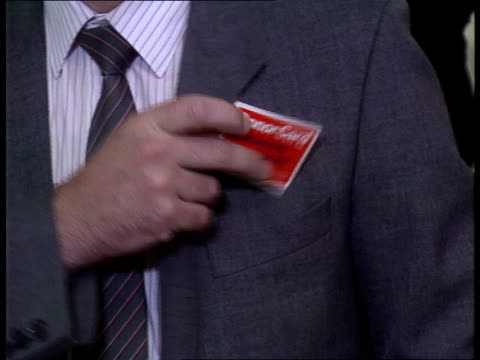 computerised system considered itn lib england london westminster hand displays donor card to camera cms ditto placed in top pocket of jacket seq... - hosentasche stock-videos und b-roll-filmmaterial